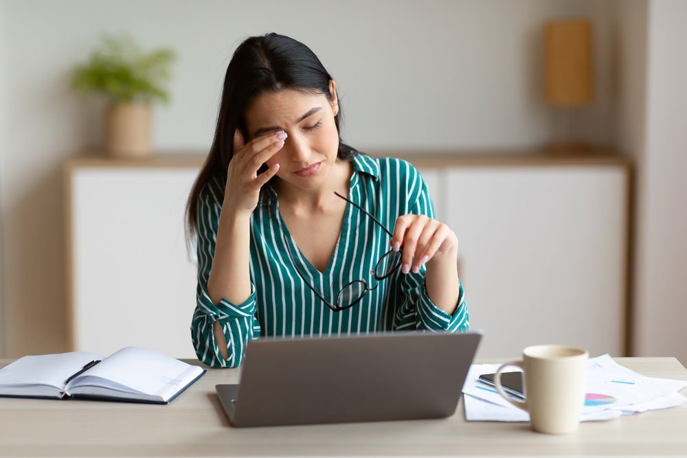 Woman rubbing eyes because she has eye strain